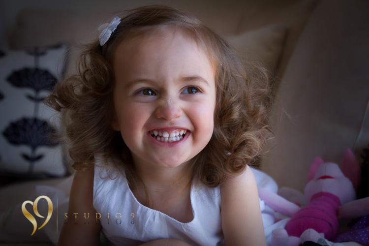 Kids photography, cute portrait of little girl.