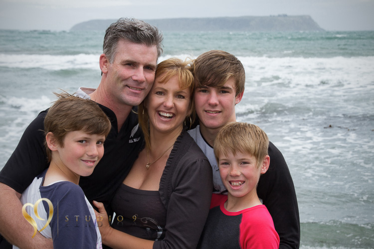 Location family portrait on the beach.