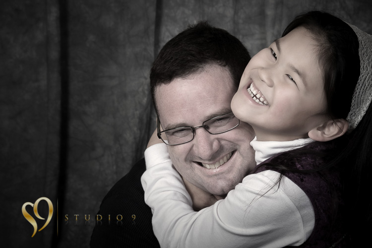 Hugs for dad, fun family photography by studio9.