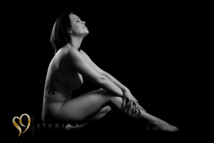 Monochrome fine art image of seated figure.
